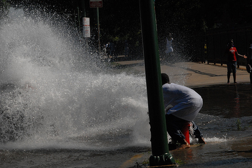 Chicago youth vandalizes cars and fire hydrant simultaneously. 2007 Photo by Patrick McDonough
