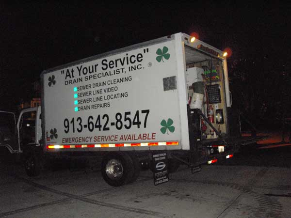 The truck arrives from At Your Service Drain Specialists Kansas