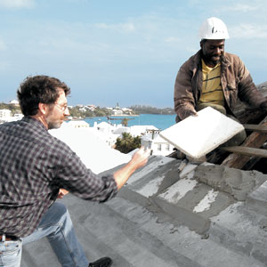 Laying limestone slates for Bermuda rain catching rooftop