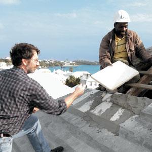 Laying limestone slates for Bermuda rain catching rooftop