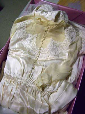 Gayle Leonards wedding dress in basement storage