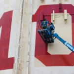 Painting class numbers on Fallbrook CA water tower