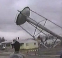 water tower crushes house
