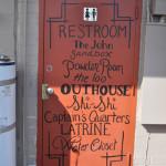Nevada bathroom door painted with toilet terms