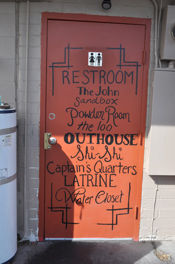 Nevada bathroom door painted with toilet terms
